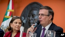 Mexican Foreign Affairs Secretary Marcelo Ebrard, right, accompanied by Mexican Ambassador to the U.S. Martha Barcena, speaks during a news conference at the Mexican Embassy in Washington, June 3, 2019.
