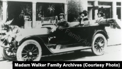 Madam C.J. Walker and her daughter A'Lelia Walker in their car.