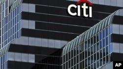 FILE - A Citibank sign in Chicago.
