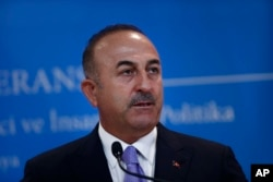 FILE - Turkey's Foreign Minister Mevlut Cavusoglu, listens to a reporter's question during a joint news conference with Russia's Foreign Minister Sergey Lavrov (not pictured), in Ankara, Turkey, Aug. 14, 2018.