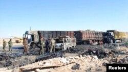 Hiện trường sau một vụ đánh bom tự sát ở thành phố Hama, Syria, ngày 20/10/2013. Cuộc nội chiến ở Syria đã giết chết hơn 100.000 người và làm cho hàng triệu người phải bỏ nhà cửa đi lánh nạn.