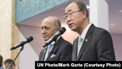 United Nations Secretary-General Ban Ki-moon, right, and French Foreign Minister Laurent Fabius, president of the United Nations climate change conference (COP21), brief the press in Paris, Dec. 12, 2015.