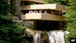 FILE - This Aug. 23, 2007 file photo shows Fallingwater, one of the late architect Frank Lloyd Wright's best-known works, which was built out over a waterfall in Bear Run, Pa.