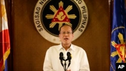 FILE - Philippine President Benigno Aquino III addresses the nation in a live broadcast from the Presidential Palace in Manila.