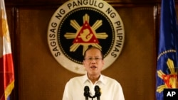 FILE - Philippine President Benigno Aquino III addresses the nation in a live broadcast from the Presidential Palace in Manila, July 14, 2014.
