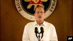 FILE - Philippine President Benigno Aquino III addresses the nation in a live broadcast from the Presidential Palace in Manila. Aquino says Philippine aircraft will continue to fly their usual routes over disputed reefs in the South China Sea.