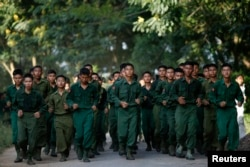 FILE - Military cadets of the Defense Services Academy exercise around their compound in Pyin Oo Lwin, Myanmar, Sept. 21, 2012. About 8,000 votes in the town are expected to come from within the Defense Services Academy. ​