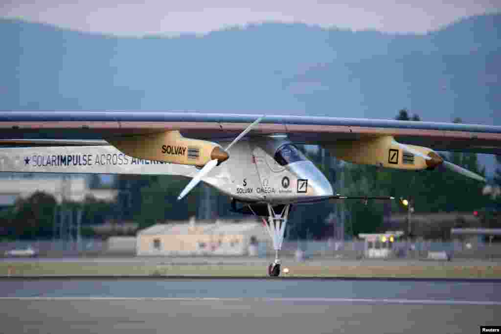 The Solar Impulse aircraft takes off from Moffett Field to begin the first leg of its 2013 Across America Mission in Mountain View, California May 3, 2013.