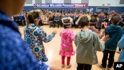 President Barack Obama attends a performance by native Alaskan dancers at Dillingham Middle School, in Dillingham, Alaska, Sept. 2, 2015.