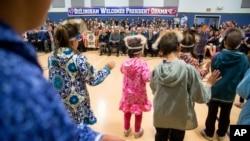 President Barack Obama attends a performance by native Alaskan dancers at Dillingham Middle School, in Dillingham, Alaska, Sept. 2, 2015.