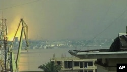 This video image taken across the Congo river in Kinshasa, Congo, shows a blast that rocked Brazzaville the capital of the Republic of Congo, March 4, 2012.