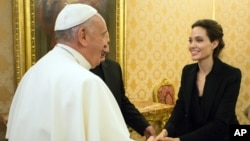 Pope Francis greets Angelina Jolie at the Vatican, Jan. 8, 2015.