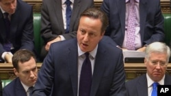 British Prime Minister David Cameron talks to lawmakers inside the House of Commons in London, Dec. 2, 2015.