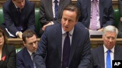 British Prime Minister David Cameron talks to lawmakers inside the House of Commons in London during a debate on launching airstrikes against Islamic State extremists inside Syria, Dec. 2, 2015.