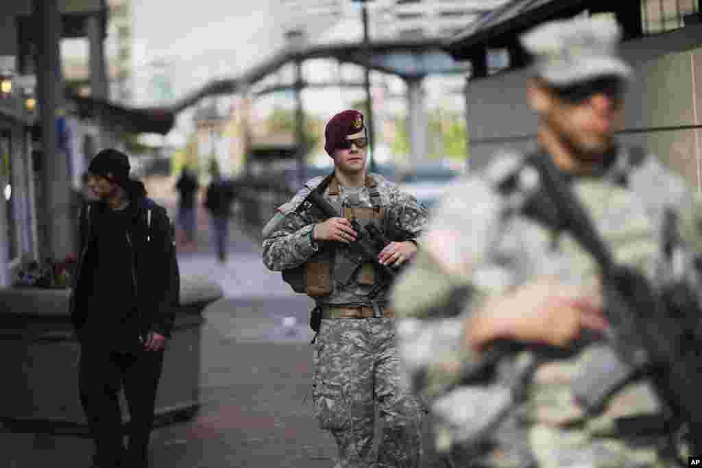 Members of the National Guard patrol along Baltimore's Inner Harbor area in the aftermath of rioting following Monday's funeral for Freddie Gray, who died in police custody in the Maryland city.