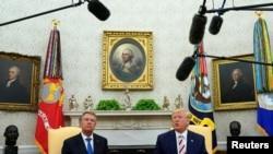 美国总统特朗普2019年8月20日在白宫与罗马尼亚总统举行会谈前答复记者提问