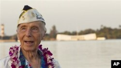 With the USS Arizona memorial in the background, Pearl Harbor survivor Richard Laubert, of Phoenix, Oregon, attends the 69th anniversary ceremony marking the attack on Pearl Harbor, 7 Dec 2010, in Pearl Harbor, Hawaii