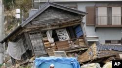 A Japanese fisherman sits among debris at a fishing port severely damaged by the magnitude 9.0 earthquake and tsunami, in Otsu town in Kitaibaraki, south of the crippled Fukushima Daiichi nuclear plant, April 22, 2011.