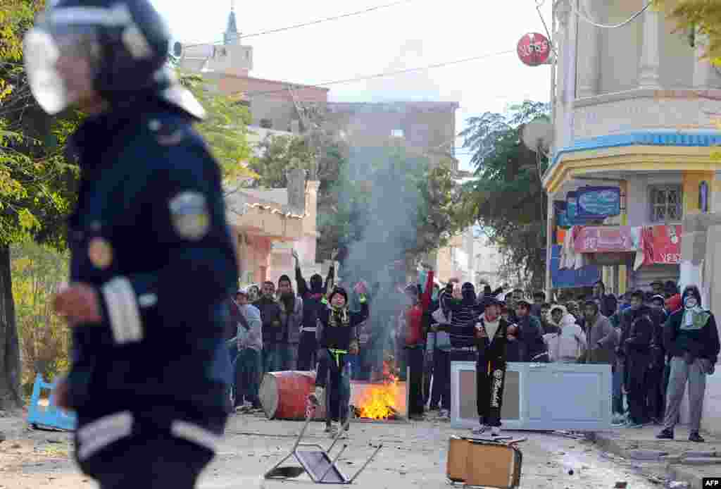 Tunisian protesters clash with police following a demonstration against the country's ruling Islamist Ennahda party in Siliana, northwest of Tunis. A general strike was called to protest against poverty and lack of development.