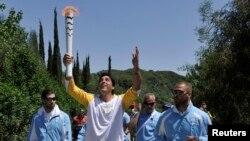 Giovane Gavio, do Brasil, na cerimónia de entrega da chama, Grécia, 21 de Abril.