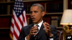 FILE - President Barack Obama speaks during an interview at the White House.