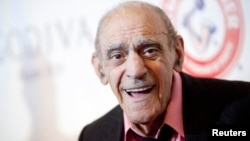 FILE - Actor Abe Vigoda smiles as he attends the Friars Club Roast of Betty White in New York, May 16, 2012.