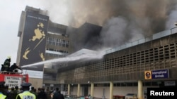 Firefighters struggle to put out a fire at the Jomo Kenyatta International Airport in Kenya's capital Nairobi, August 7, 2013.
