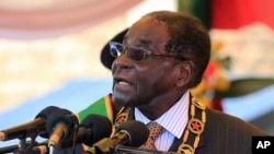 FILE - Zimbabwean President Robert Mugabe is seen delivering a speech in Harare, Aug. 10, 2015.