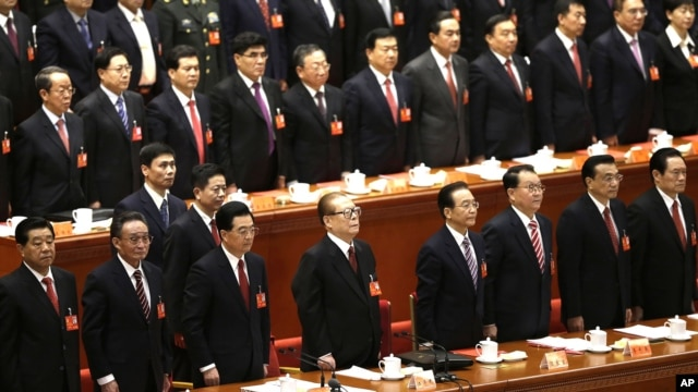 Leading party members including outgoing president Hu Jintao, (3rd left), stand singing of the Internationale, the international communist anthem, at the closing ceremony of the 18th Communist Party Congress held at the Great Hall of the People in Beijing