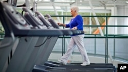 FILE - A woman, who suffers from diabetes, is seen walking on a treadmill as part of an exercise program to help control the disease.