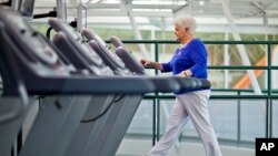FILE - A woman with diabetes walks on a treadmill as part of an exercise program to help control the disease. Researchers who recently linked diabetes with cognitive and memory issues say keeping fit can help decrease the risk of vascular dementia in diabetics.