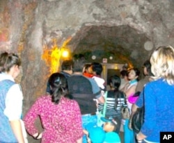 Tourists head toward the cave door at Glenwood Caverns.