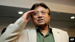 Former Pakistani President Pervez Musharraf salutes his party members during a ceremony to celebrate Pakistan National Day in Dubai, March 23, 2013.