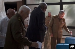 FILE - In this Dec. 27, 2016 file photo, Cuba's President Raul Castro casts his vote to elect a new member of the state council, the biannual legislative session at the National Assembly in Havana, Cuba.