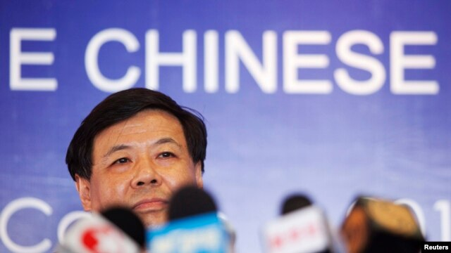 FILE - China's Vice Finance Minister Zhu Guangyao addresses the media during a news conference at a hotel in Los Cabos, Mexico.
