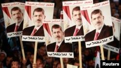 Abashigikiye prezida yakuwe ku butegetsi mu Misiri, Mohamed Morsi bafise amasanamu yiwe