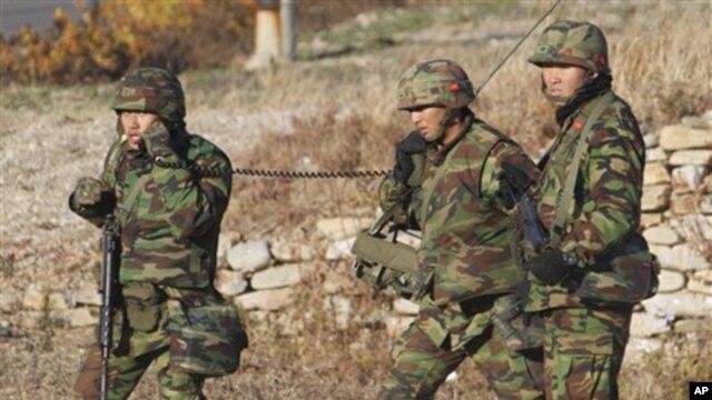 South Korean marines patrol on the South Korean island of Yeonpyeong. Nov. 26, 2010.