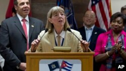 FILE - Dr. Candace S. Johnson, president and CEO of Roswell Park Cancer Institute, announces the signing of an agreement to test a Cuban lung cancer treatment in the U.S., before the New York delegation leaves the Jose Marti International Airport in Havana, Cuba, April 21, 2015.