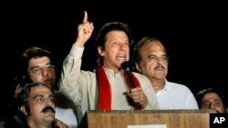 Pakistani cricketer-turned-politician Imran Khan delivers a speech during a protest in Islamabad, Pakistan, Aug. 18, 2014.