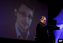 Former NSA contractor Edward Snowden participates via satellite in the 2014 Personal Democracy Forum, at New York University, June 5, 2014 in New York.