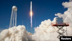 FILE - The Orbital Sciences Corporation Antares rocket is seen as it launches from Pad-0A of the Mid-Atlantic Regional Spaceport (MARS) at the NASA Wallops Flight Facility in Virginia, April 21, 2013.