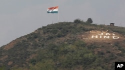"""FILE - An Indian flag flies on a hill in the Uri sector, near the de facto border dividing Kashmir between India and Pakistan, in Indian-controlled Kashmir, Sept. 21, 2016. """"Jai Hind"""" roughly translates into """"Long live India."""""""