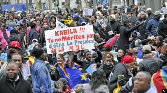 Supporters of Congo's opposition hold reading 'Kabila !!! you do not deserve DRC's Presidency' during a demonstration against what many say were deeply flawed November elections, in downtown Antwerp, DRC, December 2011. (file photo)