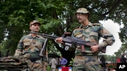 Indian army soldiers display seized arms and ammunition at the army headquarters in Srinagar, India, August 16, 2013.