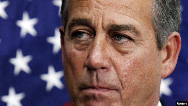 U.S. House Speaker John Boehner (R-OH) pauses during a news conference on the fiscal cliff after a closed GOP meeting at Capitol Hill, December 5, 2012.