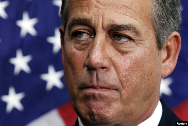 U.S. House Speaker John Boehner (R-OH) pauses during a news conference on the fiscal cliff after a closed GOP meeting at Capitol Hill in Washington, December 5, 2012.