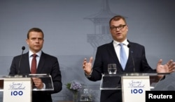 FILE - Finnish Minister of Finance and National Coalition chairman Petteri Orpo (L) and Finnish Prime Minister and Centre Party chairman Juha Sipila attend a news conference at the PM's official residence Kesaranta in Helsinki, Finland, June 12, 2017.
