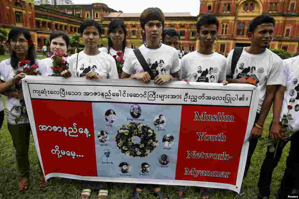 RTX1KVMV 19 Jul. 2015 Yangon, Myanmar Members of Muslims Youth Network Myanmar pose for photos during an event marking the anniversary of Martyrs' Day at the Ministers' Building, formerly known as the Secretariat Builidng, where General Aung San and eight