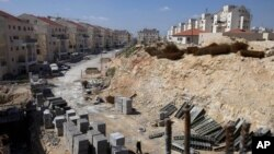 FILE- In this March 14, 2011, file photo, a general view of a construction site in the West Bank Jewish settlement of Modiin Illit. Israel approved the construction of 3,000 homes in Jewish settlements in the West Bank and east Jerusalem, a government of