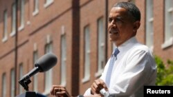 U.S. President Barack Obama rolls up shirt sleeve before speaking about his vision to reduce carbon pollution, Georgetown University, Washington, June 25, 2013.